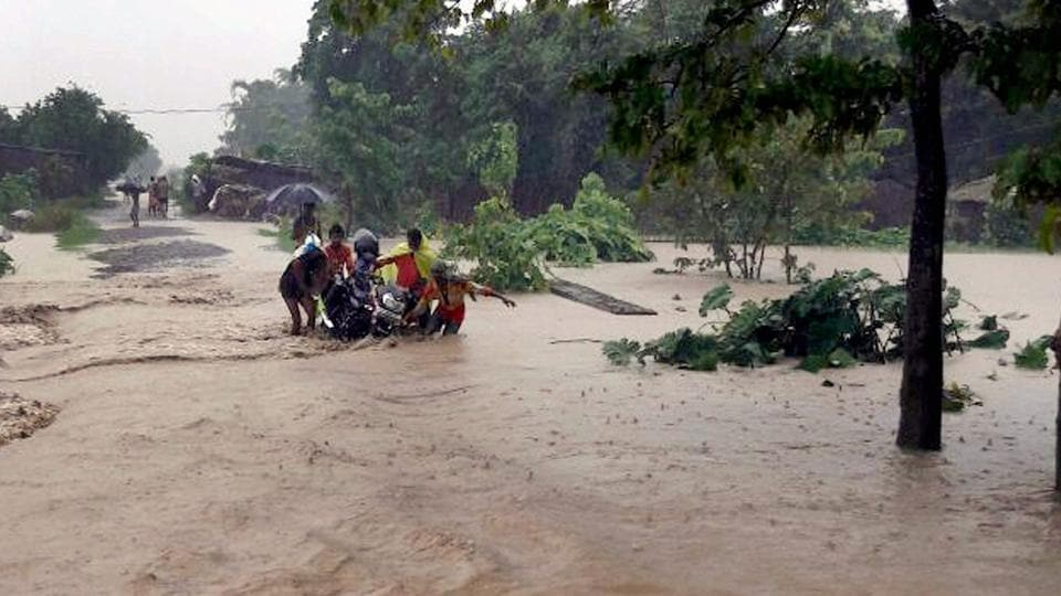 Villagers in a flood-hit area in Katihar district of Bihar on Sunday.  (PTI)