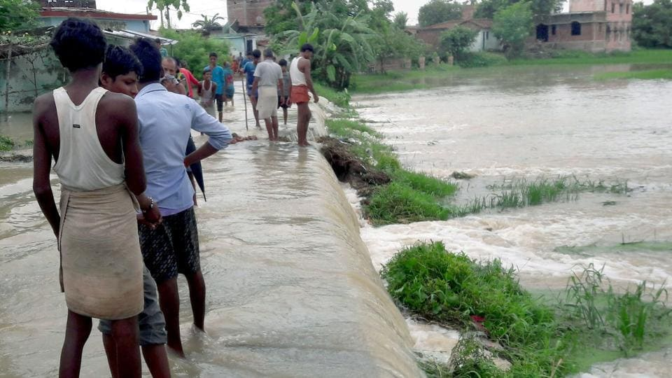 Flood waters have engulfed areas in Kisanganj, three blocks of Purnea and one block of Katihar damaging roads. (PTI)