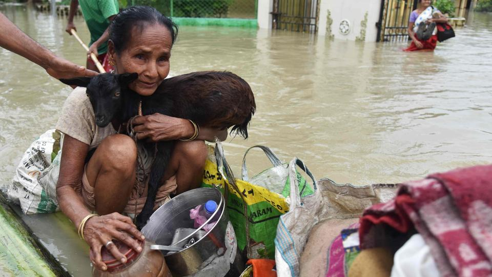 Additional personnel of national and state disaster response forces were deployed in the affected districts to rescue people. According to Assam State Disaster Management Authority (ASDMA), more than 1.83 lakh people displaced in the recent floods are taking shelter in 678 relief camps across the state.  (Biju Boro/AFP)