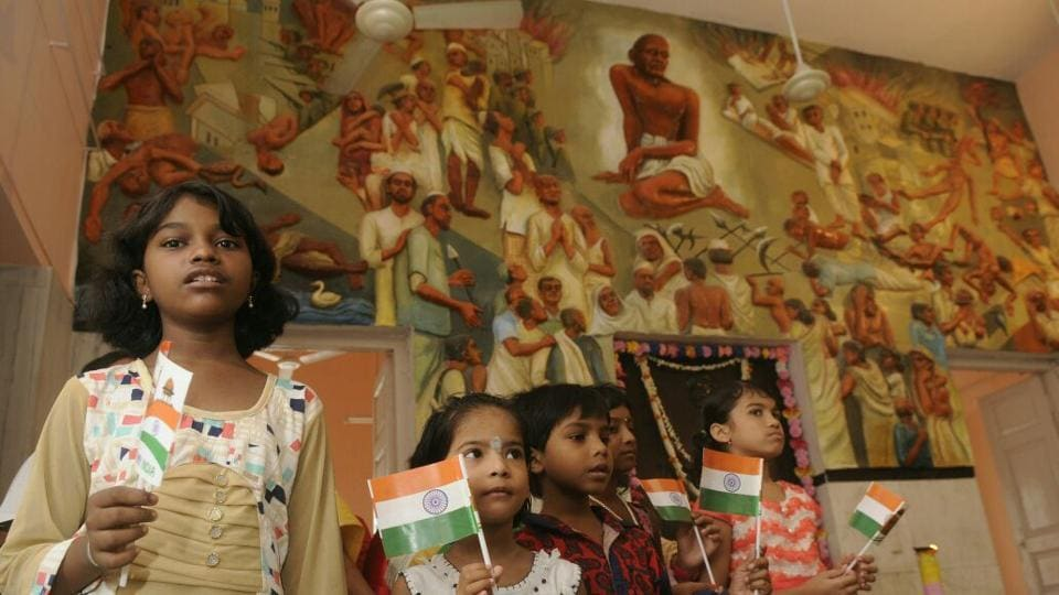 Children celebrate Independence Day at Gnadhi Bhawan, Kolkata.  (Samir Jana/HT Photo)