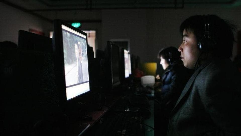 File photo of a man using a computer at an internet cafe in Shanghai in January 2009.
