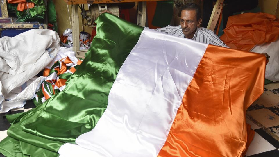 With Independence Day 2017 knocking at the door, flag makers in the country are stitching away as demand for the national flag booms. Usually seen at official buildings or landmarks the tricolour takes to the streets as August 15 draws near, being spotted at traffic lights, pinned along streets and in novelty shops all over. (Burhaan Kinu / HT Photo)