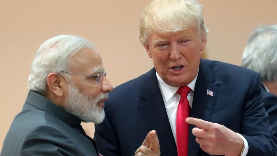 US President Donald Trump (right) talks with Prime Minister Narendra Modi as they attend a working session during the G20 summit in Hamburg, Germany, on July 8, 2017.