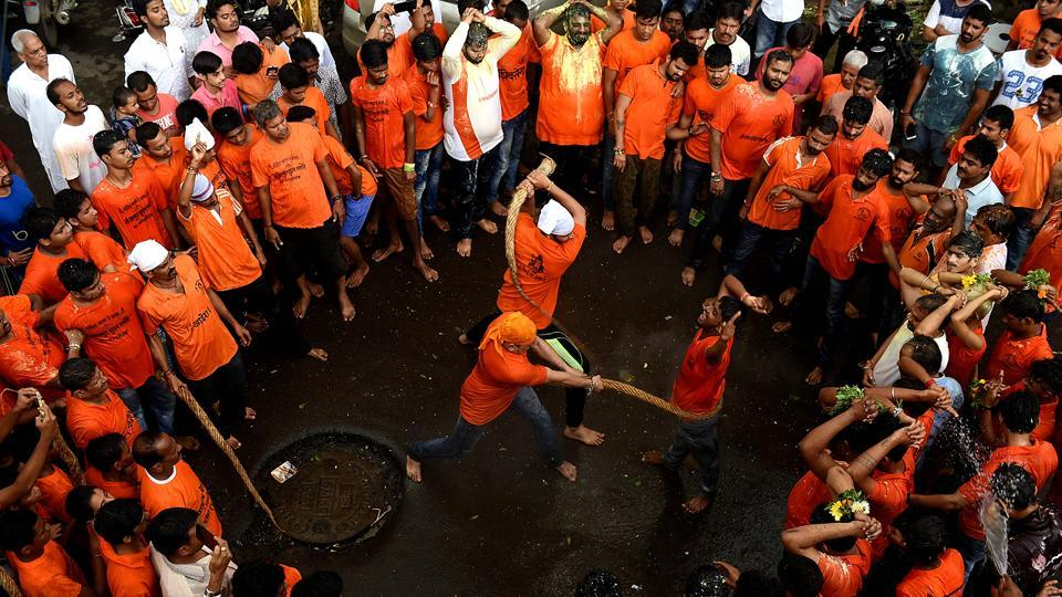Govindas being lashed, as part of a 150-year-old tradition, at Panvel in Navi Mumbai. (Bachchan Kumar/HT PHOTO)