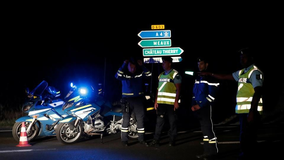 French gendarmes maintain a roadblock near the scene where a car ploughed into a pizzeria, killing a young girl and injuring several other people in Sept-Sorts.