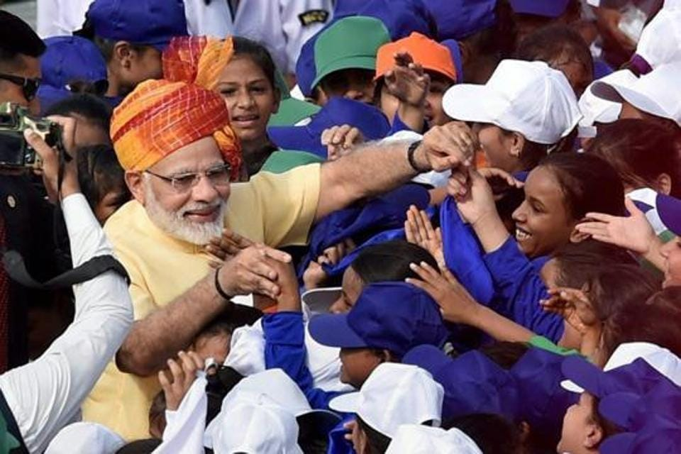 File photo of  prime minister Narendra Modi interacting with school children.