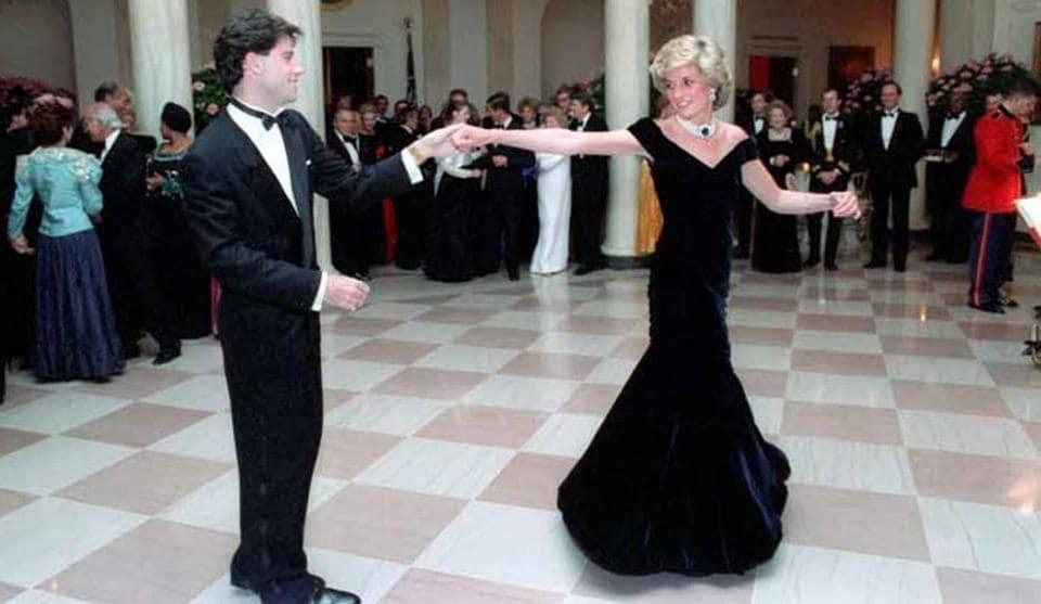 Princess Diana dances with John Travolta in the 'Travolta dress'.