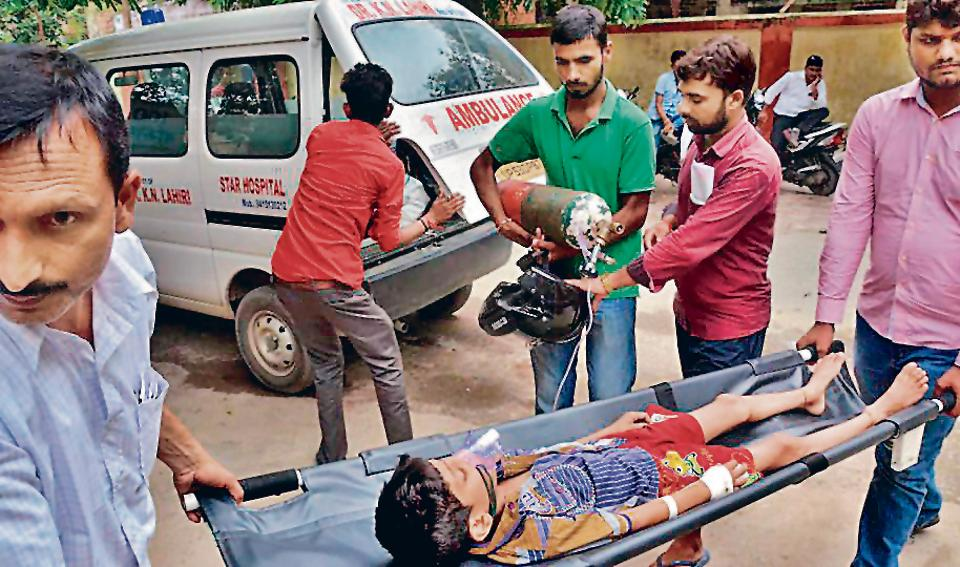 A child is being shifted to another ward at Baba Raghav Das Medical College Hospital in Gorakhpur district on Wednesday.
