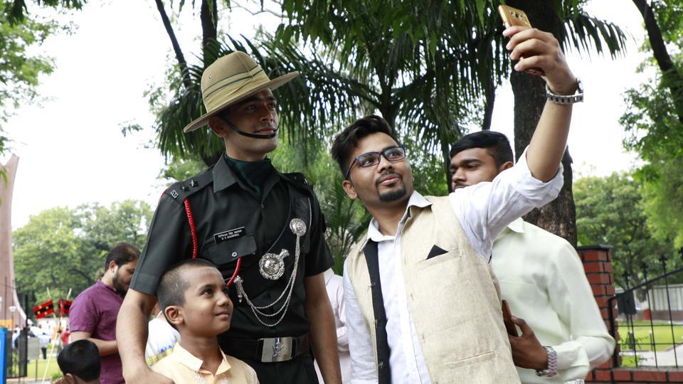 A man takes a selfie with army jawans at the Independence day celebrations at National War Memorial at camp in Pune. (Rahul Raut/HT PHOTO)