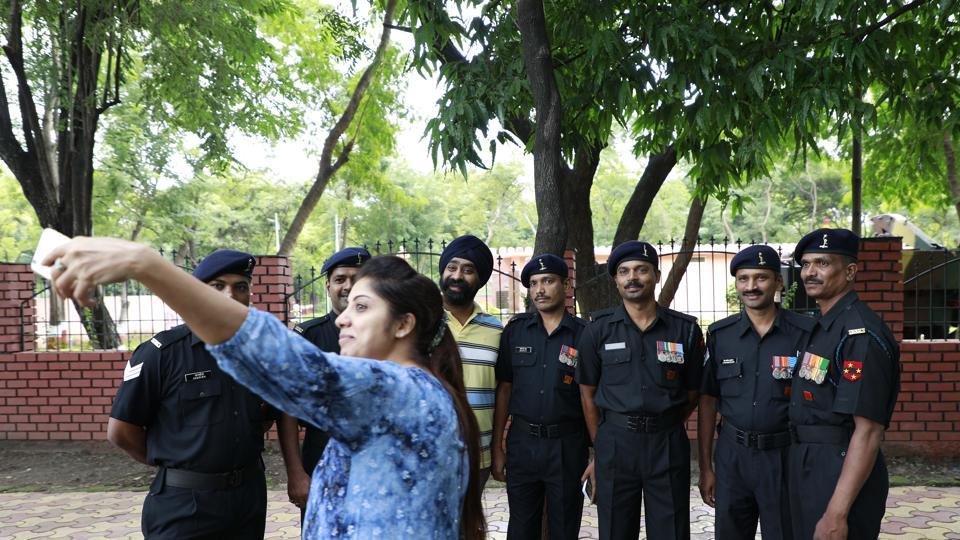 A woman takes a selfie with armymen at the Independence Day will be celebrations at National War Memorial in camp on Tuesday. (Rahul Raut/HT PHOTO)