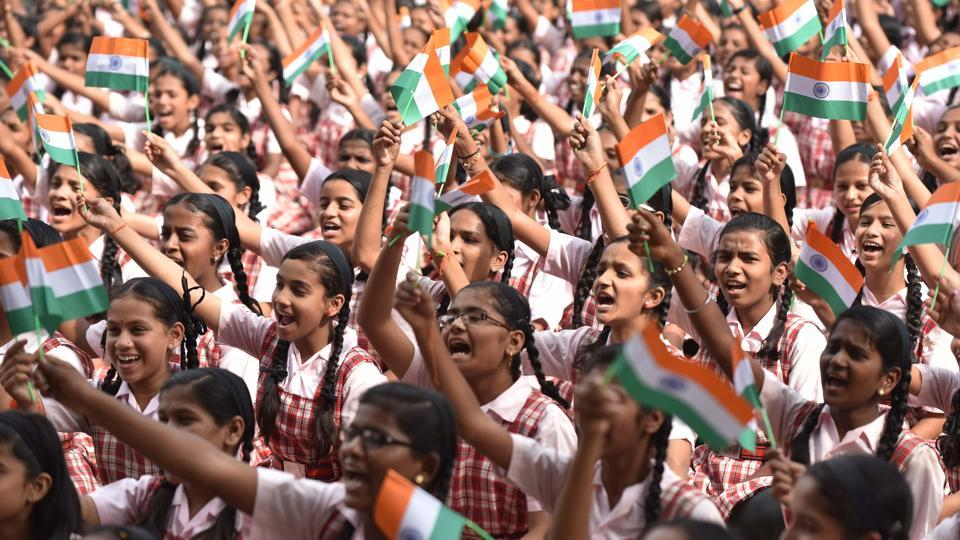 Students of Renuka Swarup school wave India's National Flag at the Independence day celebrations in Pune on Monday.  (Pratham Gokhale/HT PHOTO)