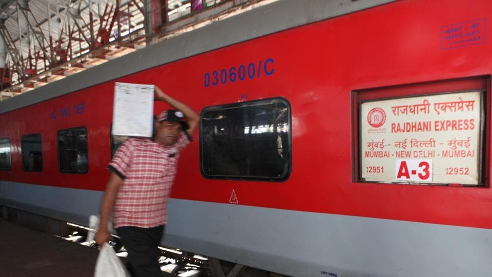 An IRCTC staffer before boarding the Rajdhani Express at Bombay Central Station.