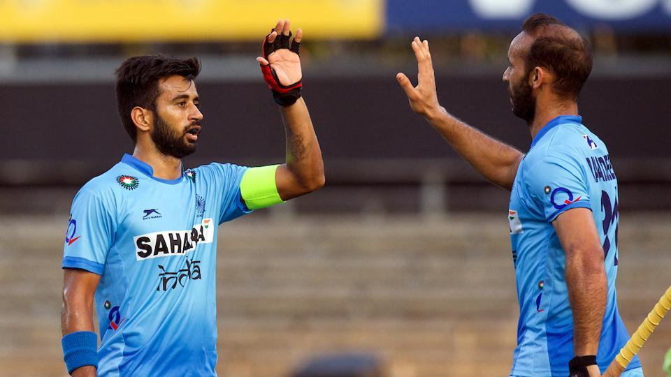 Indian hockey team player Ramandeep Singh (right) celebrates with skipper Manpreet Singh after scoring against Austria on Wednesday.