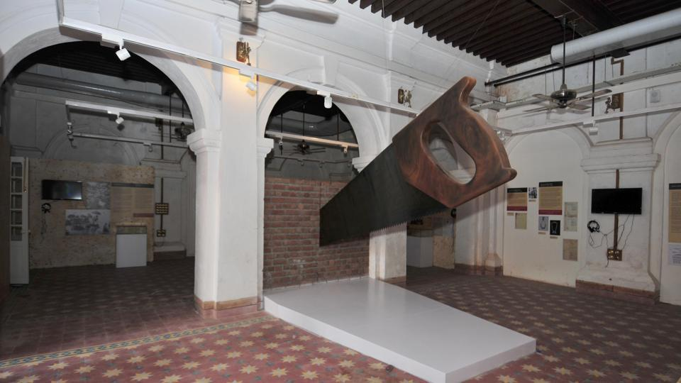 A giant saw installation cuts through a brick wall at the Partition Museum in Amritsar. The Partition Museum is a chronicle to an event that lacerated a nation and is an attempt at bridging the divide of 1947. Put together through individual efforts, supported by the government in giving this colonial building for display, the museum is a work in progress with material related to 1947 trickling in as people share stories and mementos related to the troubled times. (Ravi Kumar / HT Photo)