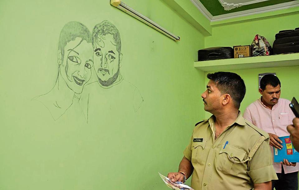 A policeman inspects the flat of the Rudrapur woman who was shot dead  outside her society in Ghaziabad on Thursday afternoon.