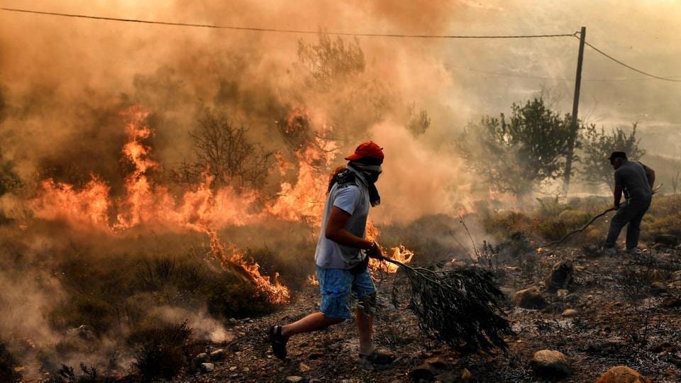 On Zakynthos, an island popular with foreign tourists, a dozen fires burned for a fifth day. Justice Minister Stavros Kontonis stated there was no doubt the fires had been set deliberately. The fire service said an incendiary device had been found in a forest on the island of Samos on Tuesday. (Aris Messinis / AFP)