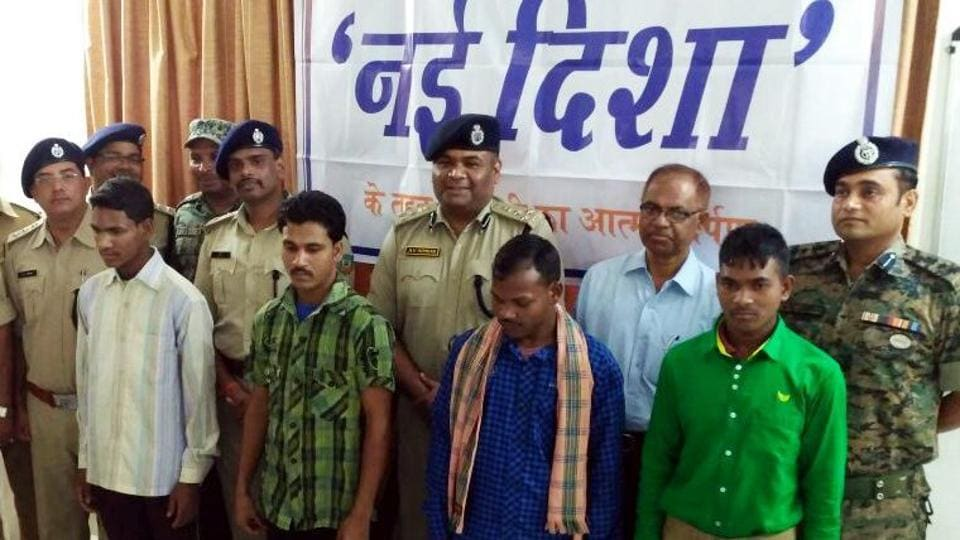Senior police officials with four Maoists who surrendered in Lohardaga on Wednesday