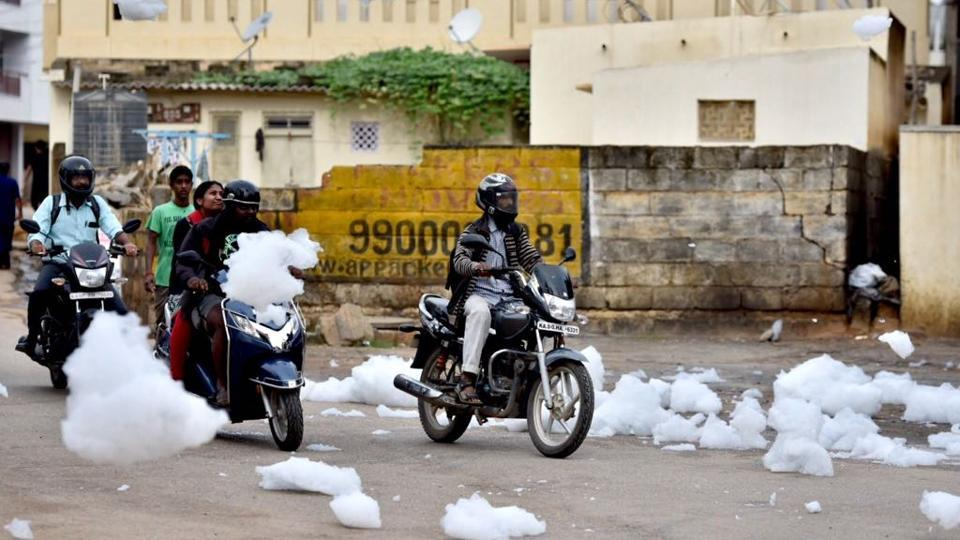 One among Bengaluru's nearly 600, Bellandur Lake has become a symbol of the city's struggle with waste management. Waves of froth were seen spewing again this week, spilling onto roads and carried by winds blanketing cars and leaving neighbourhoods with a severe stink. Residents report 'terrible stench' as fresh frothing washes over all efforts to clean the lake that has been polluted by sewage and industrial  effluents. (Arijit Sen/HT Photo)