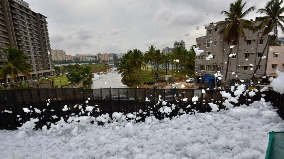The New Indian Express reported that the city's fire department was sprinkling water on Wednesday to control froth from spilling over to the main road and residents reported a terrible stink from the lake. (Arijit Sen/HT Photo)
