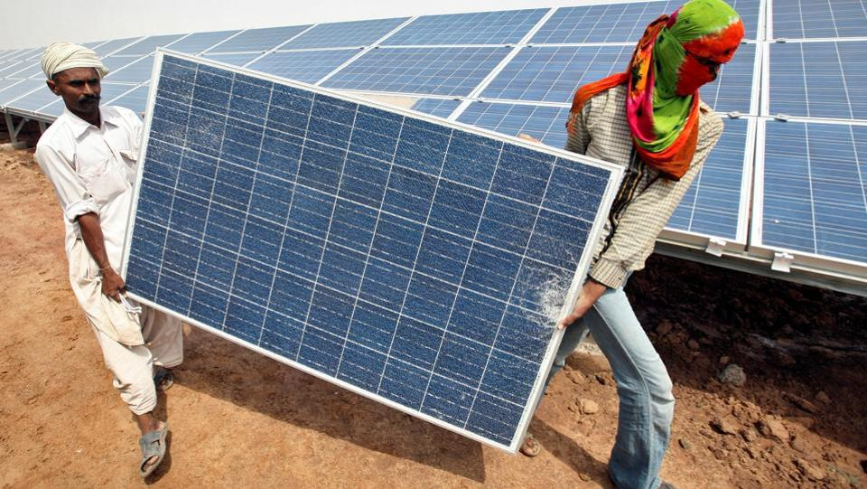 India's solar power tariffs hit a new low of Rs 2.44 per unit in May at the auction of 500MW of capacity at the Bhadla solar park in Rajasthan. According to The National Institution for Transforming India (NITI Aayog) such lower tariffs have the potential to derail India's emerging solar ecosystem such as the much needed job market. India's 100 gigawatt (GW) solar energy drive by 2022 has the potential to create as many as 1 million full time jobs.  (REUTERS)