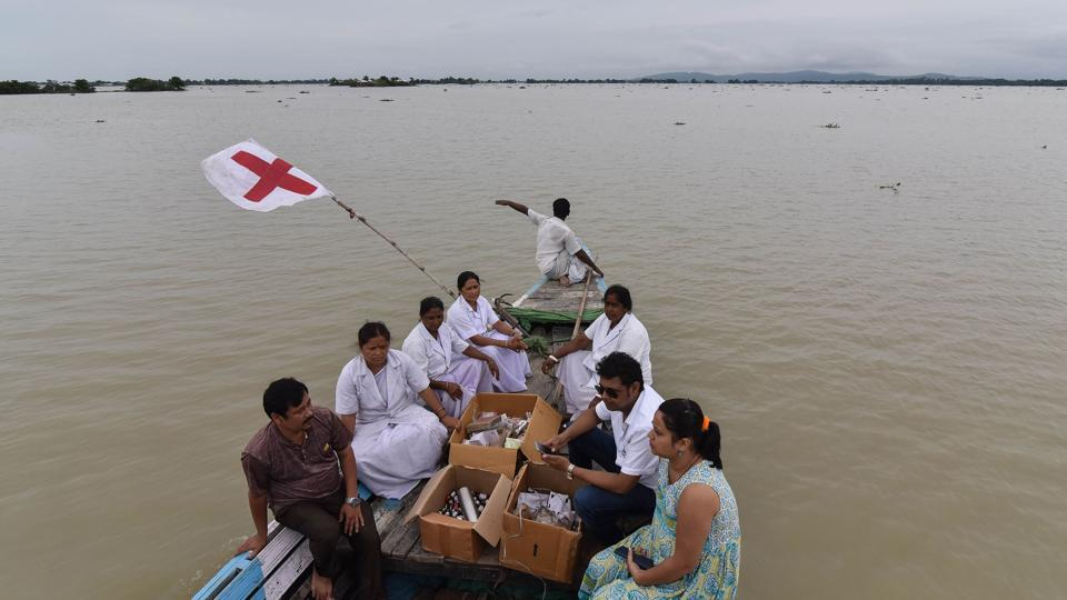 Medical officials of the Jhargaon Public Health Centre travel in a boat to a medical camp in flood-affected Morigaon district in India's northeastern Assam state on August 18, 2017. At least 221 people have died and more than 1.5 million have been displaced by monsoon floods across India, Nepal and Bangladesh, officials have said.
