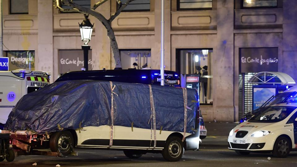 A van weaved onto a promenade and barrelled down a busy walkway in central Barcelona on Thursday, swerving as it mowed down pedestrians. Thirteen people were killed and 100 injured, in what authorities called a terrorist attack. Cars, trucks and vans have been the weapon of choice in multiple extremist attacks in Europe in the last year.  (Javier Soriano/AFP)