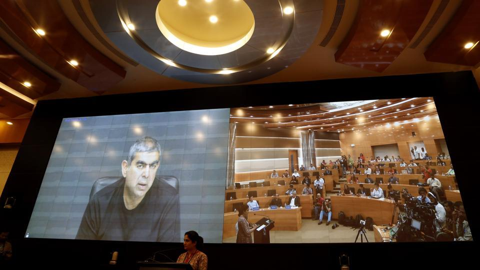 Infosys former CEO Vishal Sikka speaks from California through a video conference to journalists at company's headquarters in Bangalore, on August 18, 2017.