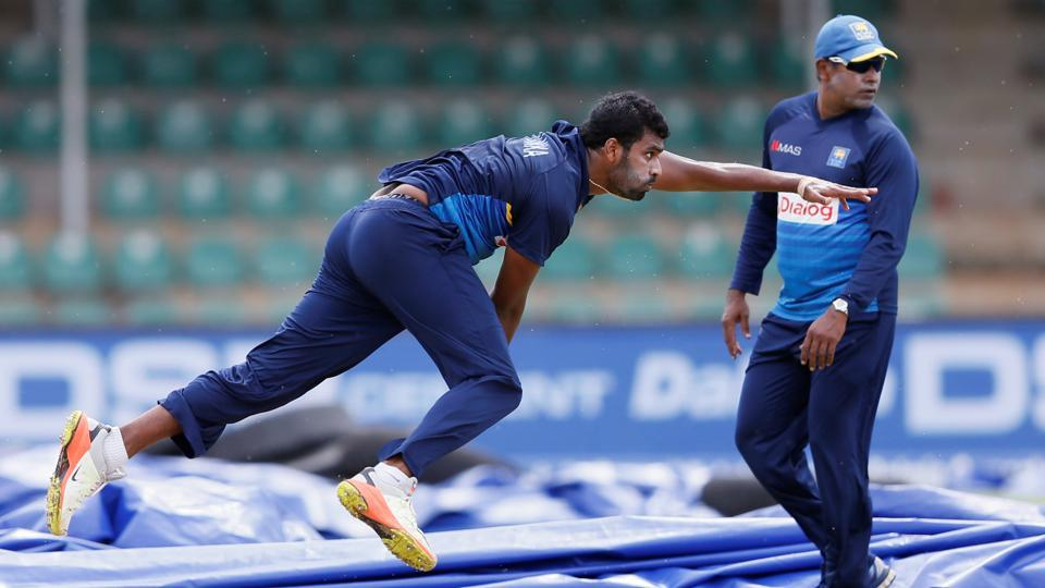Sri Lanka's Thisara Perera bowls next to coach Chaminda Vaas ahead of their first ODI vs India. (Reuters)