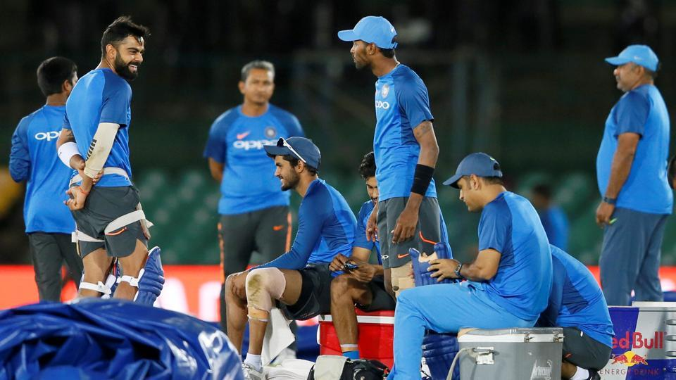 India captain Virat Kohli shares a moment with teammate MS Dhoni and other members ahead of the 1st ODI in Dambulla against Sri Lanka. (REUTERS)