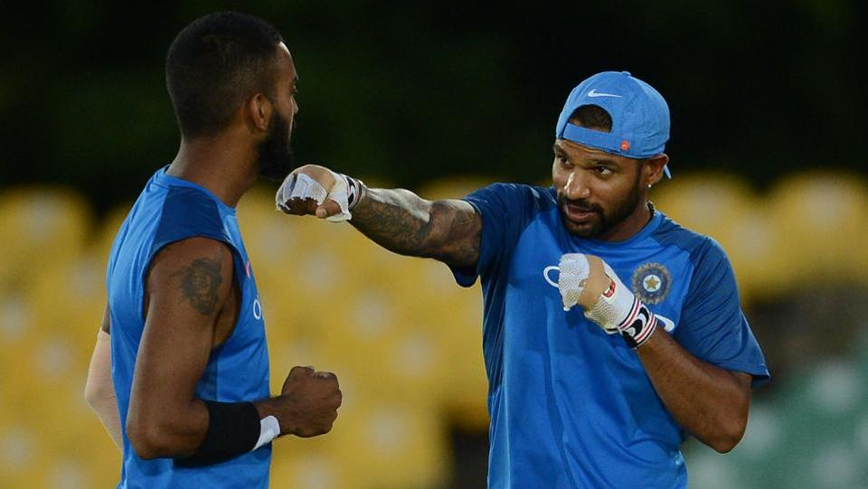 Opener Shikhar Dhawan (R) shares a light moment with teammate Lokesh Rahul during the practice session. (AFP)