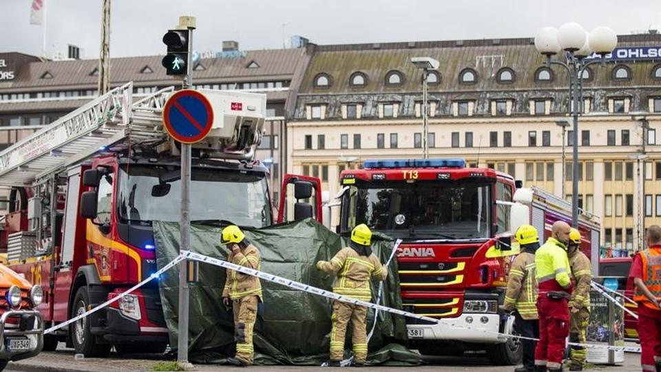 Rescue personnel cordon the place where several people were stabbed, at Turku Market Square, Finland August 18, 2017.