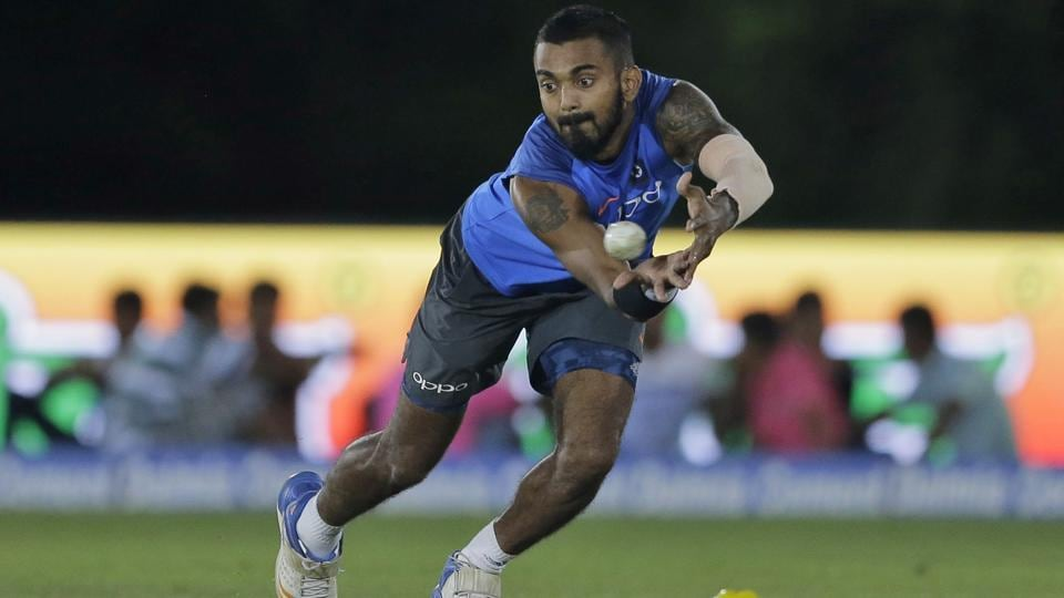 Lokesh Rahul fields a ball during a practice session under lights. (AP)