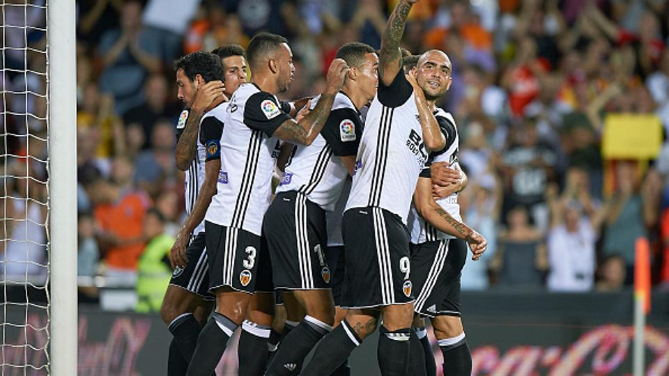 Simone Zaza (R) of Valencia celebrates with his teammates after scoring the winner against Las Palmas in their opening game of the La Liga campaign at Estadio Mestalla on Friday.