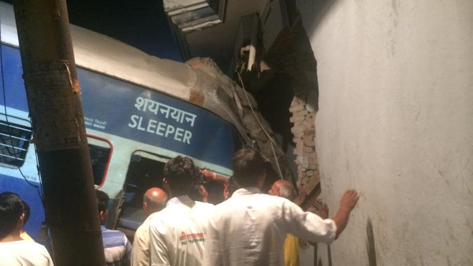 The S2 coach of the Puri-Haridwar Utkal Express juts into the house of Jagat Singh after the train derailed in Khatauli near Muzaffarnagar on Saturday.