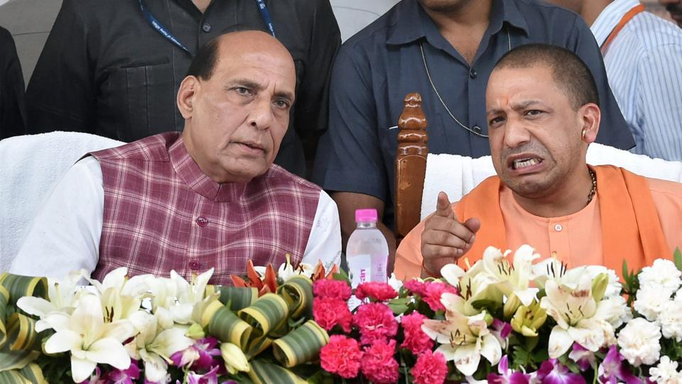 Union Home Minister Rajnath Singh with Uttar Pradesh Chief Minister Yogi Adityanath during a function to distribute loan waiver certificates to farmers under 'Fasli Rin Mochan Yojna' in Lucknow on Thursday. (PTI)