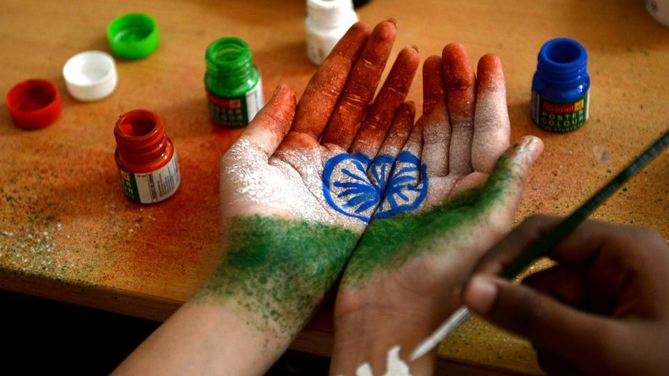 A student has their hand painted with the Indian national flag at an event to celebrate Independence Day on August 15, 2017, in Chennai.