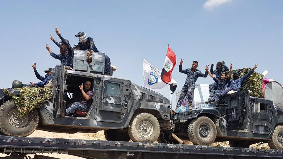 A handout picture released by the Iraqi Federal Police on August 15, 2017, shows Iraqi armoured units headed for the town of Tal Afar, the main remaining Islamic State (IS) group stronghold in the northern part of the country.
