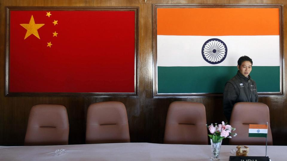 A man walks inside a conference room used for meetings between military commanders of China and India, at the Indian side of the Indo-China border at Bumla, in the northeastern Indian state of Arunachal Pradesh.