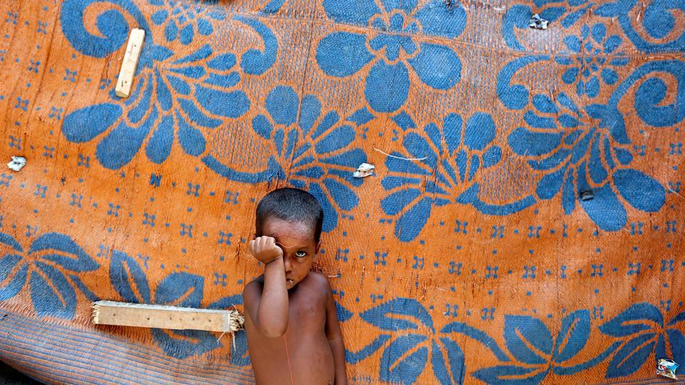 A boy from the Rohingya community stands outside a shack in a camp in Delhi. (Cathal McNaughton /REUTERS)