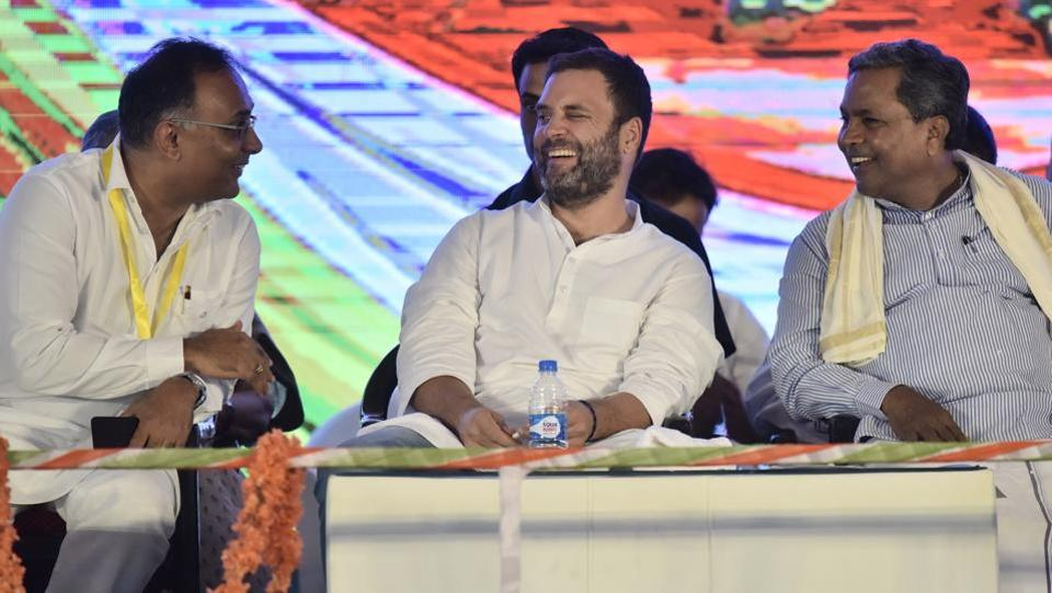 (L-R front row) Dinesh Gundurao, Congress vice president Rahul Gandhi and Karnataka Chief Minister Siddaramaiah shares a light moment during a public meeting at National College ground in Bengaluru, India, on Wednesday (Arijit Sen/HT Photo)