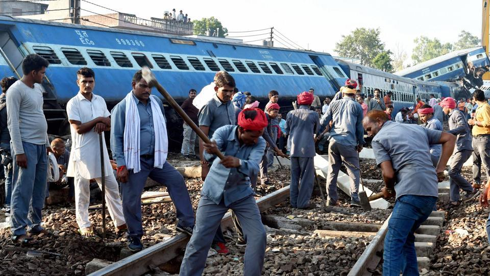 Workers repair the rail track on Sunday after the Kalinga Utkal Express derailed in Khatauli near Muzaffarnagar on Saturday evening.