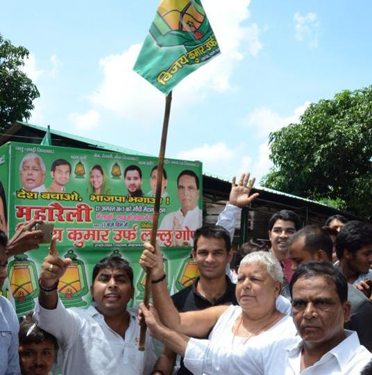RJD chief Lalu Prasad flagging off the 'maharally rath', ahead of his August