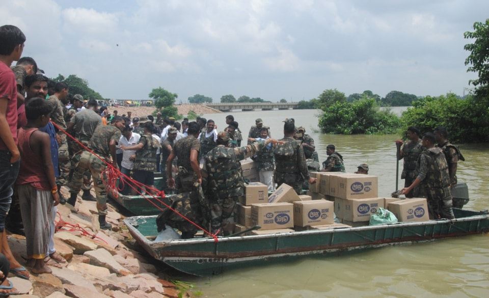 Army providing relief material to people in a flood-affected area in Gorakhpur.