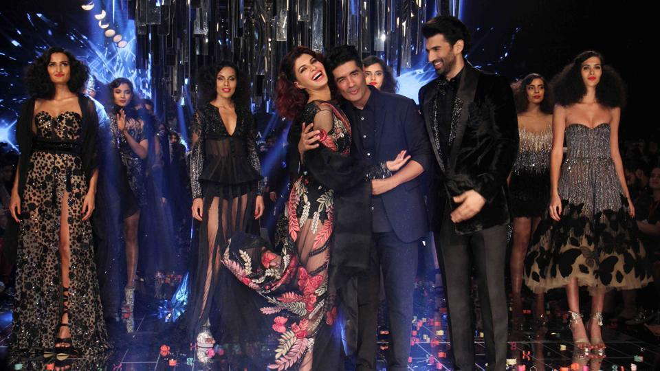 Designer Manish Malhotra with his showstoppers, actors Jacqueline Fernandez and Aditya Roy Kapoor.