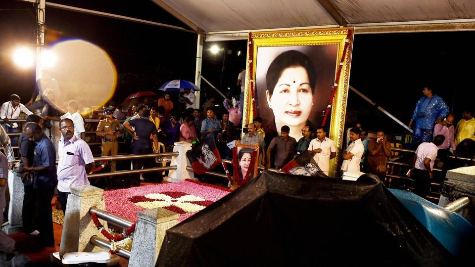 AIADMKsupporters throng late CMJ Jayalalithaa's memorial site to offer their prayers, in Chennai. Two AIADMKfactions that had a fallout after Jayalalithaa's death in December reunited on Monday.