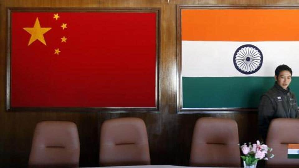 A man walks inside a conference room used for meetings between military commanders of China and India, at the Indian side of the Sino-India border at Bumla, in Arunachal Pradesh.