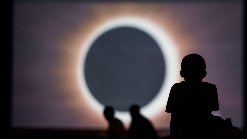 Children watch a presentation about the eclipse during a drive-in movie at the Historic Columbia Speedway, Columbia, South Carolina, August 20