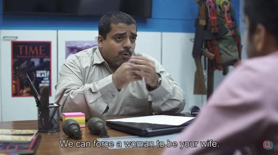 In the video, ISIS is a corporate entity and one of its executives is trying to retain a bored and disheartened employee who wants to quit.