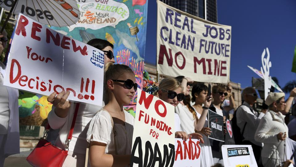 Environmental activists voice their opposition to Indian miner Adani's proposed Carmichael coal mine, outside Parliament House in Brisbane, Australia on May 25, 2017.