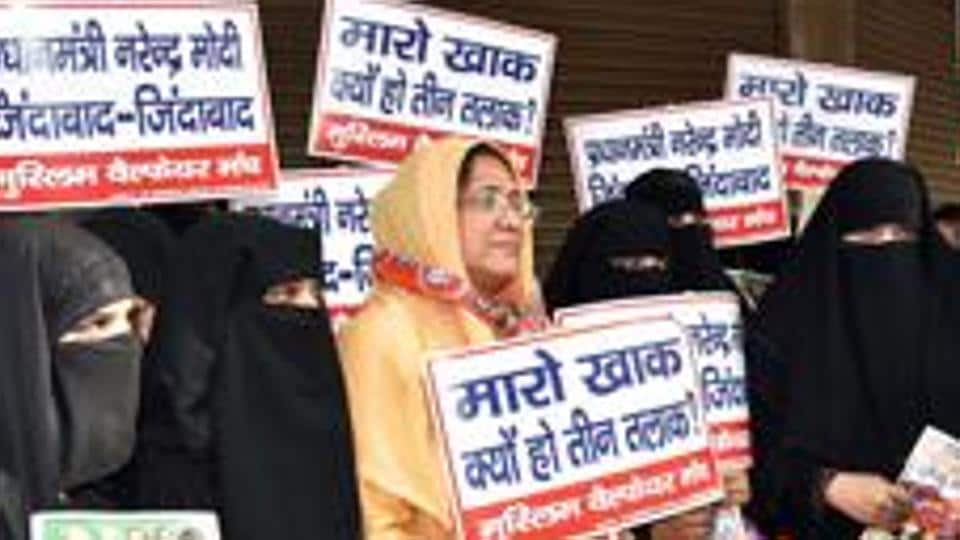 Women hold placards against triple talaq, in New Delhi.